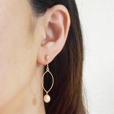 Dangle gold hoop & orange freshwater pearl invisible clip on earrings
